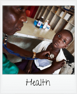 health - child getting check-up with health practitioner